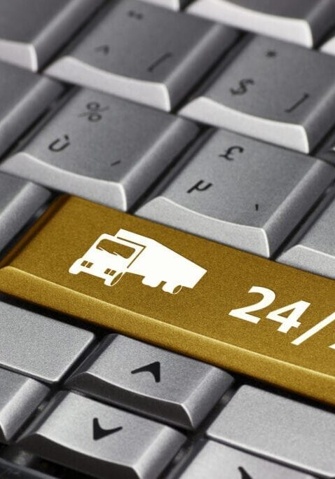 Computer Key gold - 24/7 with truck symbol