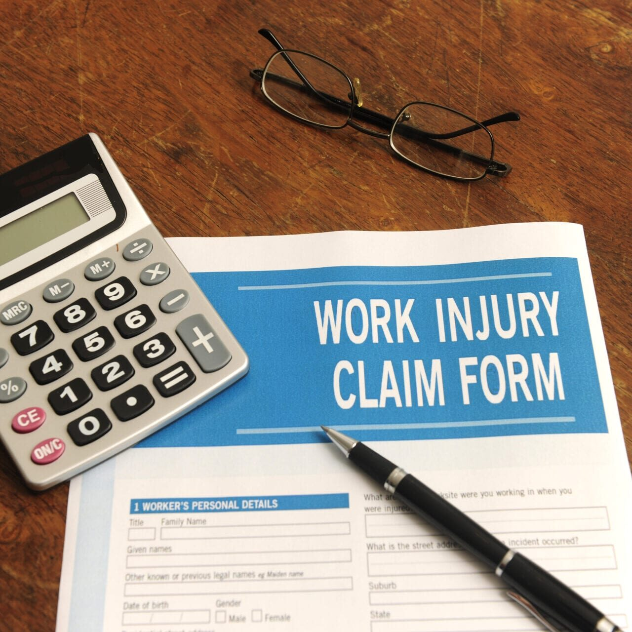 insurance: blank work injury claim form on desk ** Note: Shallow depth of field
