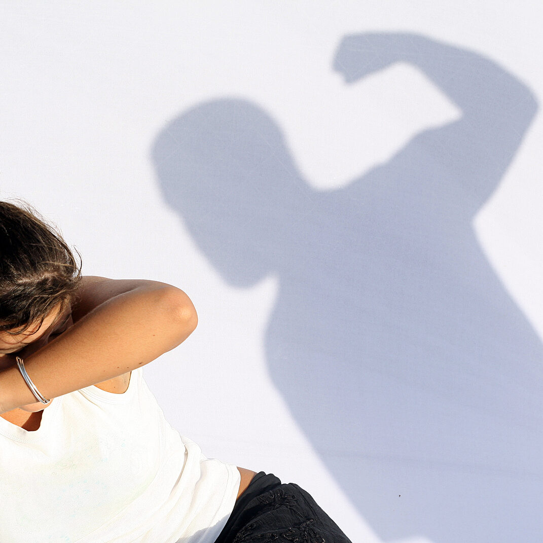 wife abuse violent man hitting frightened woman or child